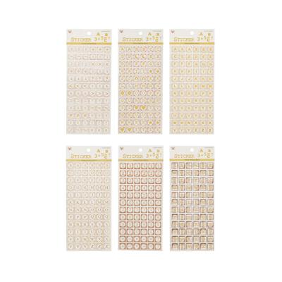 Adesivo-de-Papel-Simbolos-Branco-com-Dourado